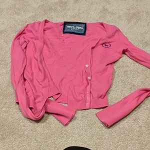Pink long sleeved cropped waist cardigan